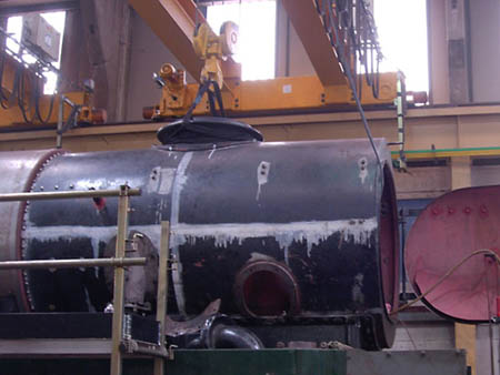 Chimney lowered into place on the smokebox of 34059 - John Fry - October 2008