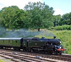 80151 enters Horsted Keynes, passing the new memorial garden - 27 June 2009 - Derek Hayward