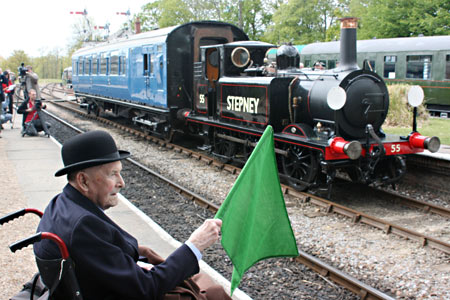 Bernard Holden flags Stepney and 6575 into Horsted Keynes - Tony Sullivan - 17 May 2010