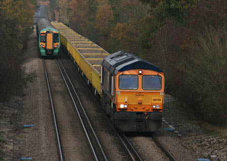 66728 heads towards East Grinstead with the empty wagons for today's waste train - Tony Sullivan - 16 November 2011