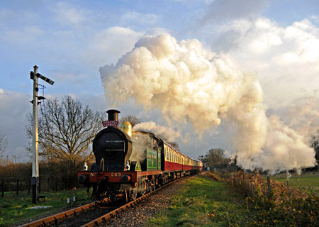 H-class with Wealden Rambler passing the Sheffield Park advanced starter - Derek Hayward - 3 December 2014
