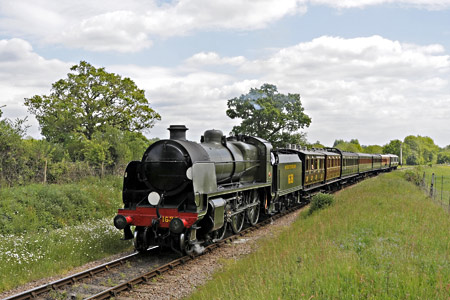 U-class leaving Sheffield Park with the vintage set, amidst the daisies - Derek Hayward - 25 May 2015