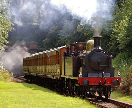 The relaunch train emerges from the tunnel at West Hoathly - 28 July 2007 - Derek Hayward