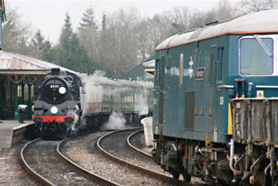 Spoil train empties pass service train at Kc - Tony Sullivan - 17 Feb 2009