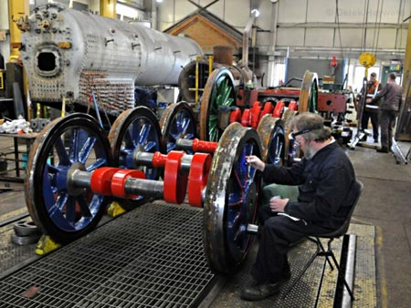 Lewis Nodes applies lining to the wheels of 323 'Bluebell' - Derek Hayward - 8 May 2010