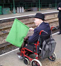 Bernard Holden flags the recreation of the inaugural train into Horsted Keynes from Ardingly - Richard Clark - 17 May 2010