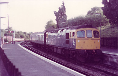 Class 33 with ECS at the South end of East Grinstead - Martin Malins - 1983