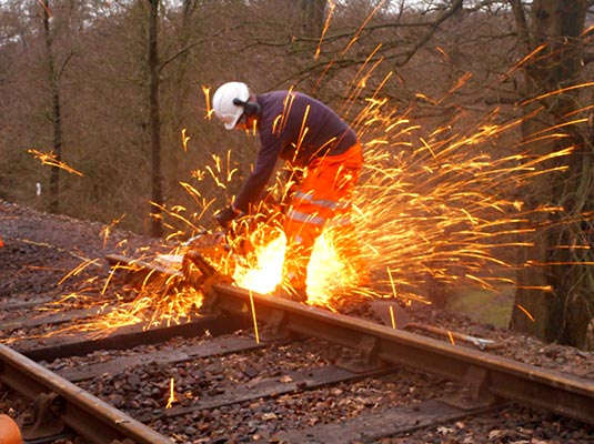 Andy Palmer cutting the old rail to length - Jon Goff - 6 February 2019